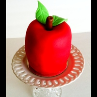 Mini Red Apple Mad this for a sweet friend's birthday. She's the principal at our Christian school. It's strawberry covered in fondant. The...