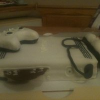 Xbox 360 Controllers are made from rice krispy treats. Game Disc is made from Melted Chocolate. Cake is Chocolate with homemade buttercream icing...