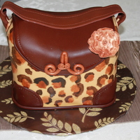 Ms.avery's Cake  My first purse cake, and my first time hagling with animal print! Its a chocolate cake, with a toffee hazlenut fill. I must say thanks to...