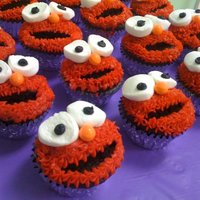 Elmo Cupcakes Elmo Cupcakes: chocolate cupcakes with crescent shape cut out for mouth then red icing piped on with star tip. Necco wafers used for eyes...
