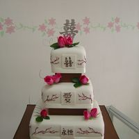 "Doubble Happiness Wedding Cake the bride asked me to decorate 3 Asian symbols: in the top ""double happiness"", in the middle ""love"" and in the bottom &..."