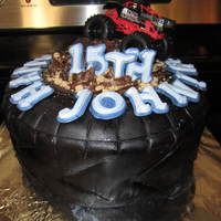 Tire Cake Tire cake made with two layers (two 9inch rounds) Satin fondant (black) first wrapped on the round of the cake, than a separate round on...