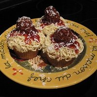 Spaghetti With Meatballs  basic cupcake with white buttercream icing with a sprinkle of cocoa to slightll darken piped with a small round tip (wilton round #3) and...