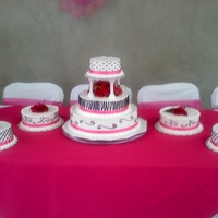 Pink And Black Wedding Cake This cake was made for a friend that wanted a combination of pink and black on her cake. Made with buttercream frosting and white cake. 14&...