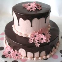 Pink Daisies And Ganache Flowers done in fondant/gum paste mix, pink IMBC topped with dark chocolate ganache.