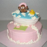 Monkey In A Bubble Bath This was for a friend's baby shower. The bathtub is cake, the monkey is fondant, the ducky is rubber. Strawberry cake with vanilla...