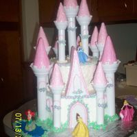 Princess Castle Cake This was for my daughter's 7th birthday. I used the Wilton Castle Kit and added the Disney Princesses. The cake is Buttercream. The...