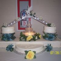 Candice's Wedding Cake This is a Wilton Cake Design. It is buttercream with silk flowers and pearls. This is the biggest wedding cake I've done so far. We...