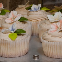 Wedding Cupcake Almond cupcake with maple frosting. Gumpaste hydrangea dusted with colors of the wedding theme.