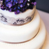 Three Tier Wedding Cake With Fresh Hydrangeas And Lace Three tier Wedding cake with fresh Hydrangea flower arrangement finished off with satin ribbon and gorgeous lace filled with chocolate mud...