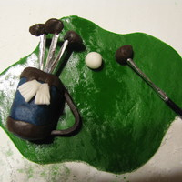 Fondant/modeling Chocolate Golf Decorations These were decorations used on a retirement cake. Made with fondant and Modeling chocolate.
