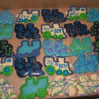 Baby Shower Cookies Sugar cookies, some with color flow covering, others with just frosting. Train theme. The dark color was a nice change to the baby blue.