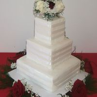 My First Wedding Cake My first attempt at a wedding cake for my cousin. Three tier square with fondant, with white satin ribbons and pearl trim. Fresh flower...