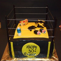 "Boxing Ring Cake   12"" Boxing ring cake. Yellow cake filled with chocolate ganache and custard. All decorations are made out of MMF"