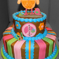 Hippie Chick Cake  This is a cake I made to coordinate with the Hippie Chick party theme. Iced in chocolate buttercream with marshmallow fondant accents &amp...