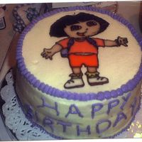 Dora Cake This was a 2 layer choc cake with buttercream icing and the image done in glaze