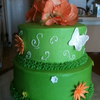Green And Orange Cake green cake with orange and white flowers