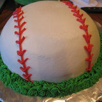 Baseball Cake This is a cake I made for a friend's son for his birthday. He loves baseball. It was a yellow cake with crusting buttercream icing.