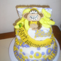 Gone Bananas Monkey Cake. The monkey and banana are made of fondant. Mini bananas in gift box are the marshmellows that were sold at Easter. The lid on...