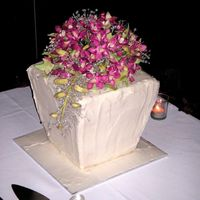 Singapore Orchid Wedding Cake  Square, four-tiered, vase-shaped wedding cake topped with sugar Singapore Orchids. Lemon cake filled with lemon curd and iced in vanilla...