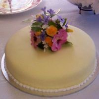 Kitchen Tea Cake  Marble cake iced in fondant with a posy of pansies, roses, violets and filler flowers. I inadvertently matched the colour of the bride-to-...