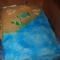 Beach_Cake2.jpg  Half sheet, cherry chip cake with faux fondant icing. Golden oreos for sand and blue spray for the water. White and peach colored chocolate...