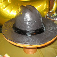 Deputy Patrol Hat carved hat out of yellow pound cake. Covered in fondant.