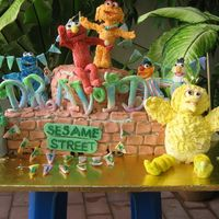 Sesame Street 6 kilo semolina cake with butter icing. The characters are made from sugarpaste. I made this for my son's 2nd bday yesterday. The...