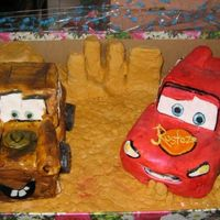 Lightning Mc Queen Mater was small boxes covered in fondant cos my cake didnt come out right and McQueen was chocolate cake covered with fondant.
