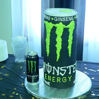 Dave's Monster Can This is for a guy who LOVES the Monster Energy drink. It's 15 1/2 in high and 6 in diameter. Covered with fondant and then piped on...