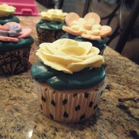 "Random Cupcakes I decided to try different decorations on cupcakes I made. The icing is a ""teal"" color, and I used royal icing roses and gum..."
