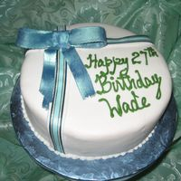 Img_1909_3.jpg This is a Jamaican Fruit Cake covered with fondant and decorated with a gumpaste bow and satin ribbon.