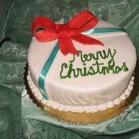 Img_1913_2.jpg   This is a Jamaican Fruit Cake covered with fondant and decorated with a gum paste ribbon and satin ribbon.