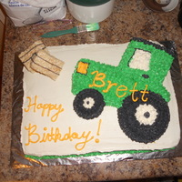 Tractor Cake This is a regular sheet cake, we cut out the tractor from the other thin cake we made and used regular buttercream icing... Added rice...