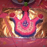 Crowncake This was a regular sheet cake that was hand cut to look like a crown.... Using cupcakes to look like the diamonds......