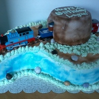 Thomas The Train this is actually an ice cream cake with just the tunnel on top cake