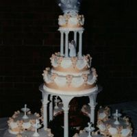 Surrounded By Hearts The unique thing of this cake is the way it is iced. From an old Celebrate Wilton book, the design uses waxed paper scallops that are...