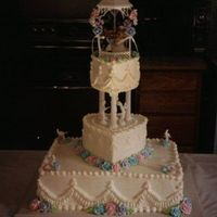 "Small Cake For Small Wedding The wedding was their second and they didn't want a big affair. The color scheme was multiple colors. 12"" square, 9"" heart,..."