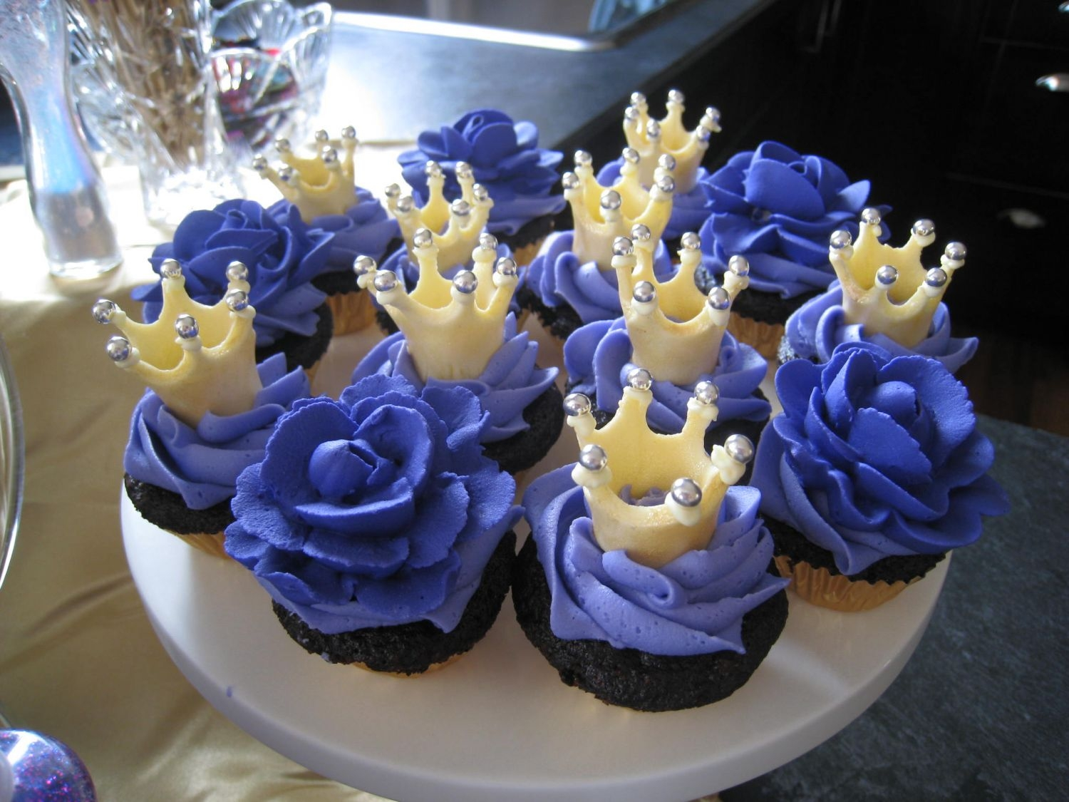 Crowns-N-Roses Cupcakes for the princess party.No sugar added chocolate cupcakes, buttercream icing. MMF crowns painted with gold pearl dust. Royal icing...