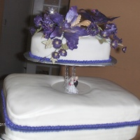 Purple Orchid Wedding Cake This cake was done to match a purple and gold theme