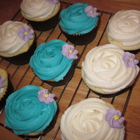 Cuppie Cakes White cake with vanilla butter cream and royal icing flowers
