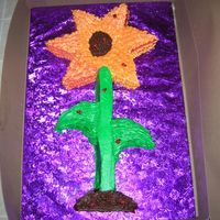 Sunflower I wasn't to thrilled about the outcome of this cake. I did this in cake class. It was 2, 8in. cakes cut up and put together. All...