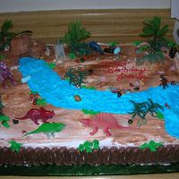 Dinosaurs Sheet cake, biggest one I've ever made. French Vanilla cake w/ fresh strawberries and whip cream filling. Very fun to make. Thanks for...