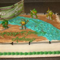 Ninja Turtles White cake w/ fresh fruit filling. All buttercream.