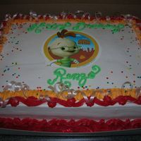 Chicken Little Edible Image Chocolate cake w/ fresh bananas and whipped cream filling.