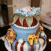 Baby Shower Cake For Twins   Jungle nursery theme. Ist baby shower cake I have made (also my 5th cake so far)Hand molded all 4 animals. 12in , 8in and 4in cakes.