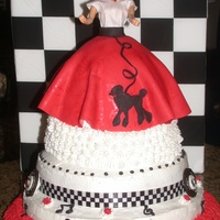 "Sock Hop Cake! This is a combo of buttercream and fondant. ""Albums"" around bottom are made from seperated Oreo cookies."