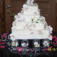 Textured Orchid Wedding Cake Cream cheese icing with a textured finish and silk orchids.