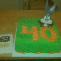Bugs Bunny 40Th Birthday Bugs Bunny cake. I used MMF and RKT with a double layer of fondant to sculpt Bugs. The base is buttercream and the hole is melted chocolate...