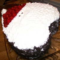 Santa Made out of a heart shaped cake pan, with chocolate cake and cherries